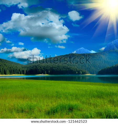 Black lake near by mountians - stock photo