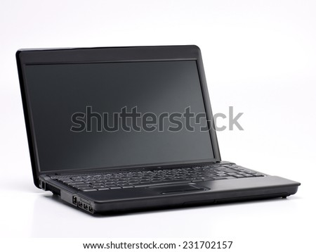 Black Laptop with Blank Screen isolated on White Background. Real Shadow. Angle View with Copy Space for Text or Image - stock photo