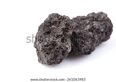 Black lava rock from Etna volcano on a white background - stock photo