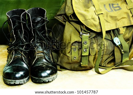 Black leather army boots and Army bag soldier - stock photo