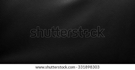 black leather background. - stock photo