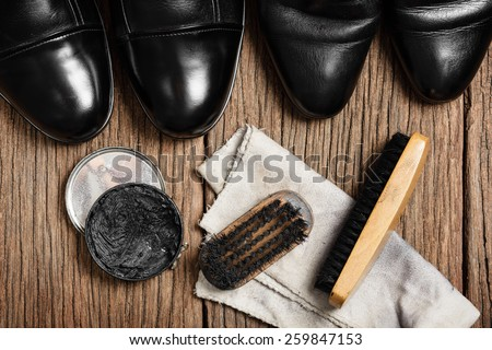 black leather boots with shoe maintenance set - stock photo