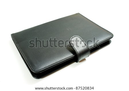 Black leather case of notebook isolated on white background - stock photo