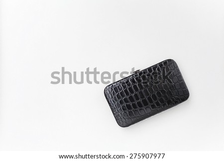 Black leather clutches bag with space on white background - stock photo