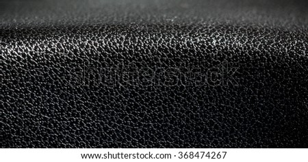 Black Leather, Genuine Leather Textured. Concept and Idea of Fine Leather Crafting, Handmade Leather Handcrafted, Background, Pattern and Wallpaper. Close up, Panorama. - stock photo