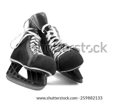 black leather ice skates isolated on white - stock photo