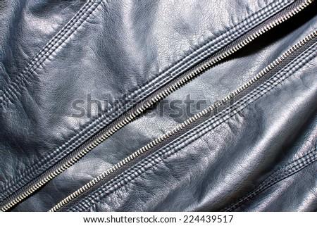 Black leather jacket texture. - stock photo