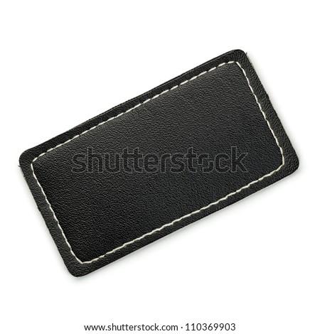 Black leather label isolated on white - stock photo