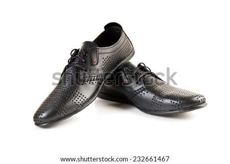 Black leather men's shoes on white - stock photo