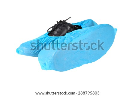 black leather mens shoes in overshoes isolated on white background - stock photo