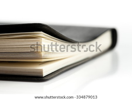Black leather notebook ,Selective focus with shallow depth of field. - stock photo