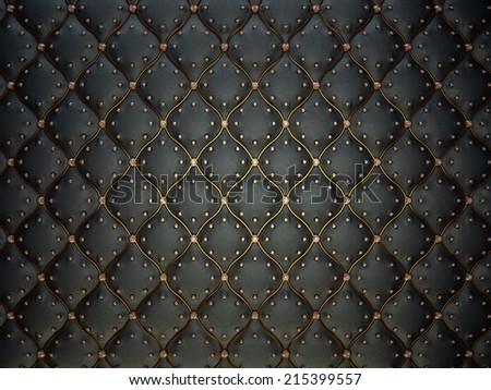Black leather pattern with golden wire and gems. Bumped background - stock photo