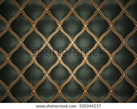 Black leather pattern with golden wire and gemstones. Luxury and wealth - stock photo