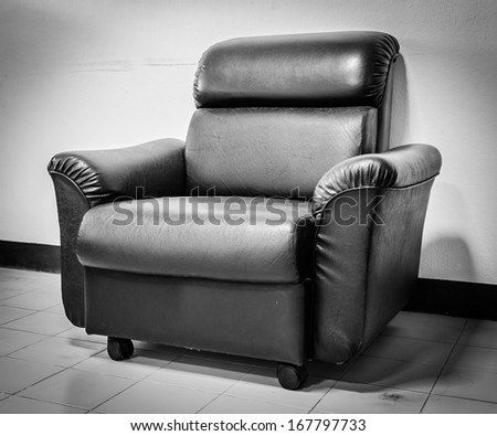Black leather sofa black and white picture style - stock photo