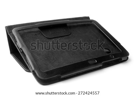 Black leather tablet computer case on white background - stock photo