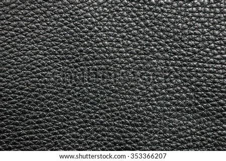 Black leather texture background. Black leather texture closeup backgroud. - stock photo