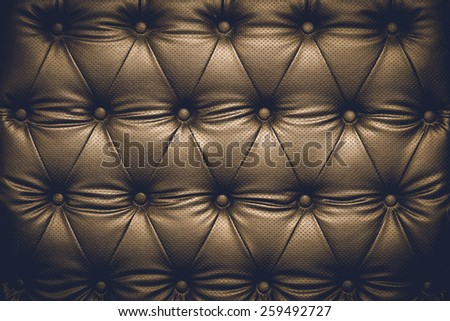 Black leather texture background with buttoned pattern - stock photo