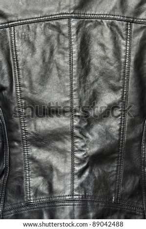 Black leather texture, jacket or clothing. - stock photo