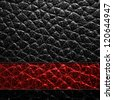 Black leather texture or background. The red stripe on black skin. - stock photo
