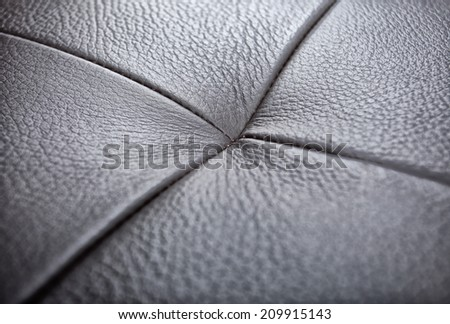 black leather texture with button - stock photo