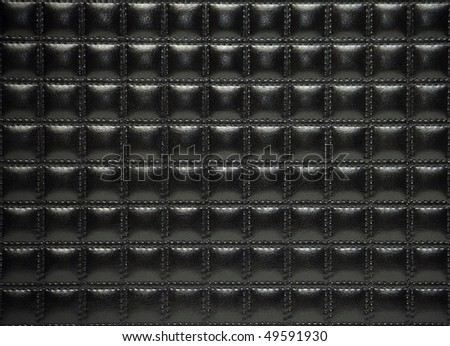Black leather upholstery of furniture - stock photo
