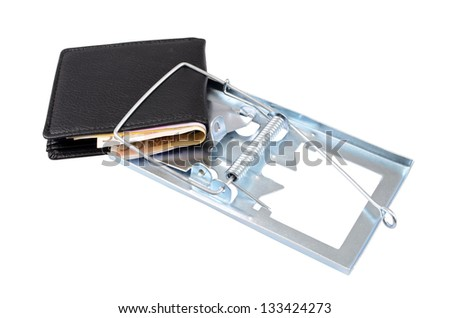 Black leather wallet with money, caught in a trap. - stock photo