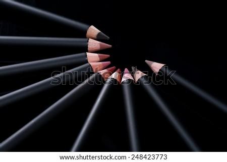 Black Lip Liner Pencils on Black Background - stock photo