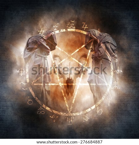 Black Magic Ritual montage with two hooded figures and a demonic ram skull encrcled within a fiery pentagram of mysterious occult symbols suggesting a black mass or magic ritual. - stock photo