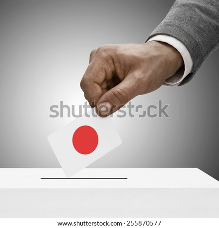 Black male holding flag. Voting concept - Japan - stock photo
