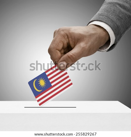 Black male holding flag. Voting concept - Malaysia - stock photo