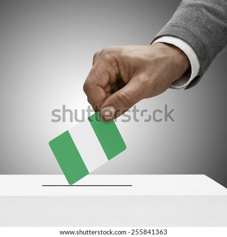Black male holding flag. Voting concept - Nigeria - stock photo
