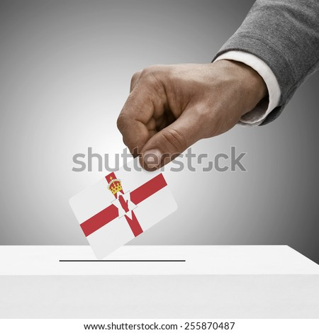 Black male holding flag. Voting concept - Northern Ireland - stock photo