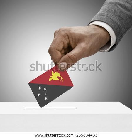 Black male holding flag. Voting concept - Papua New Guinea - stock photo