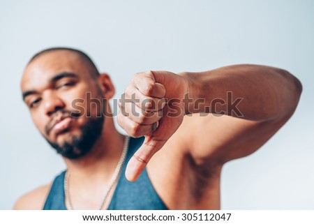 black man backs his chin with his fist - stock photo