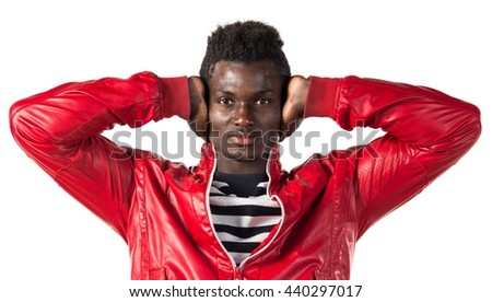 Black man covering his ears - stock photo