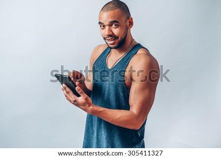 black man dials sms on the touchscreen - stock photo
