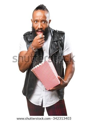 black man eating popcorn - stock photo