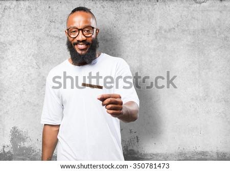 black man holding a credit card - stock photo