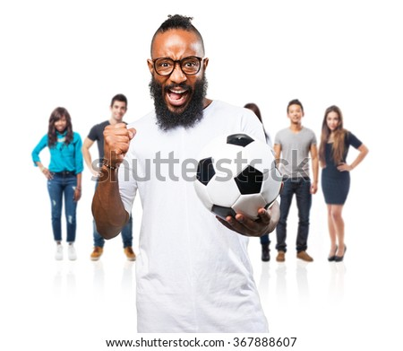 black man holding a soccer ball - stock photo