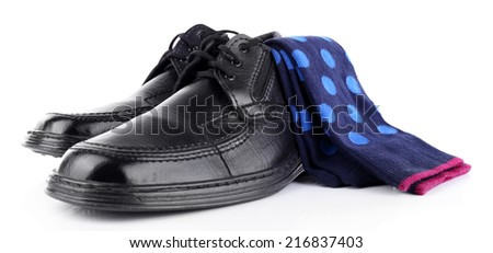 Black man's shoes and socks isolated on white - stock photo