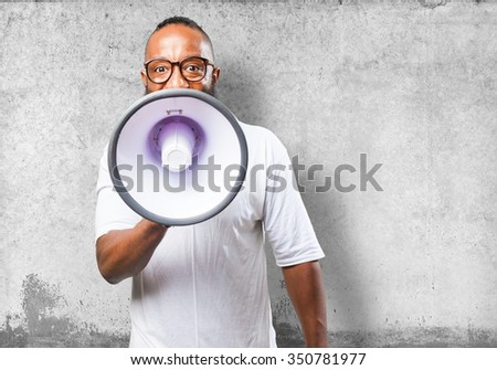 black man shouting with a megaphone - stock photo