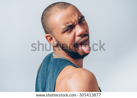 Black man shows tongue - stock photo