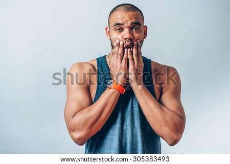 black man squeezes her cheeks - stock photo