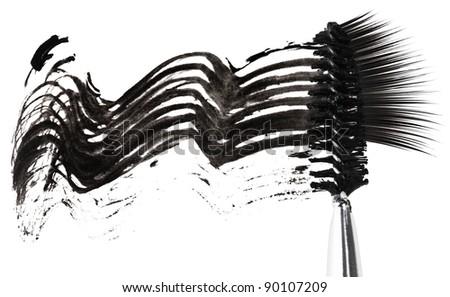Black mascara stroke, brush and false eyelashes abstract composition, on white - stock photo