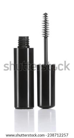 Black mascara with eyelash brush isolated on white - stock photo