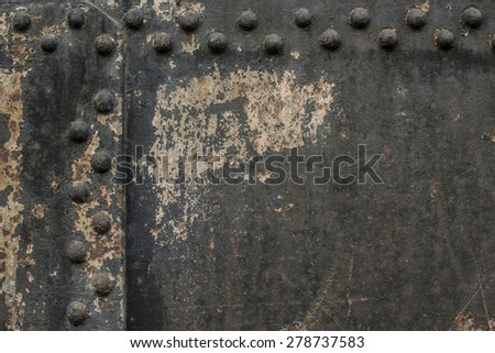 Black metal wall with rivets - stock photo