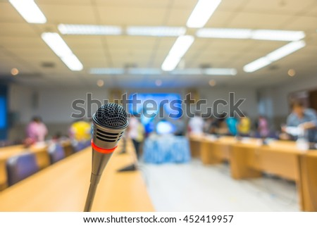 Black microphone in conference room ( Filtered image processed vintage effect. ) - stock photo
