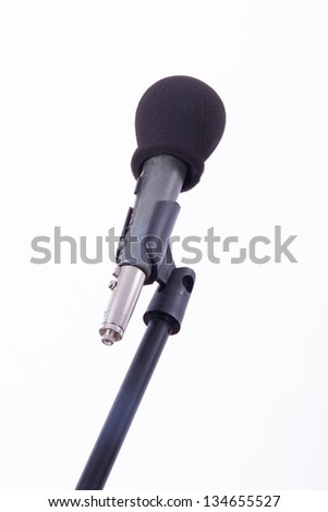 Black microphone on stand, isolated on white background. - stock photo