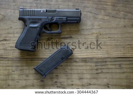 Black9mm Pistol and Magazine - stock photo