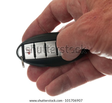 Black modern car door opener and keyless entry device with thumb pressing lock - stock photo
